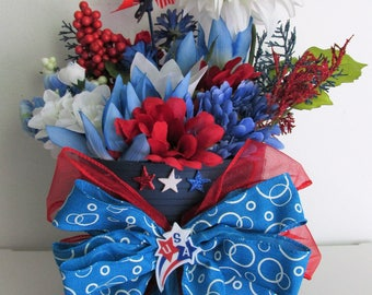 Patriotic Themed Silk Flower Arrangement Centerpiece, featuring a Pinwheel Pick, a Handmade Bow, and Flag Accessories
