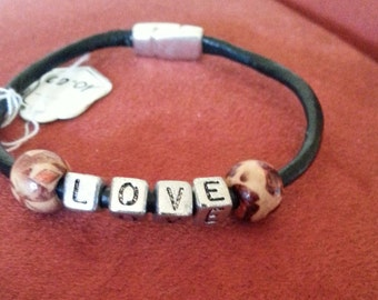Black leather bracelet with the word LOVE