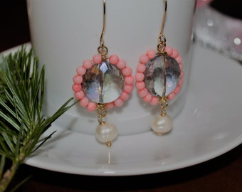 Chandelier earrings with coral, crystals and pearl .