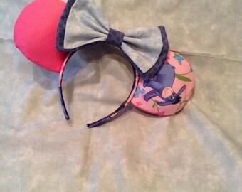 Eeyore Mickey ears with blue bow.