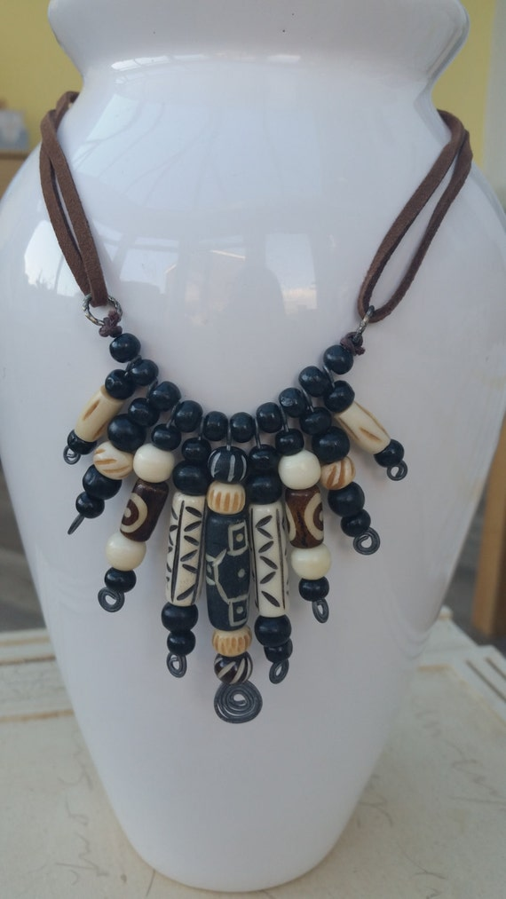Bone and wood bead necklace on suede thong