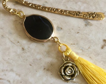 handmade bookmark, golden color with black separator and tassel