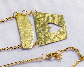 Necklace brass like gold, inlaid heart.