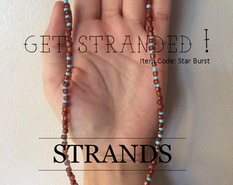Turquoise and brown beaded necklace with star pendant