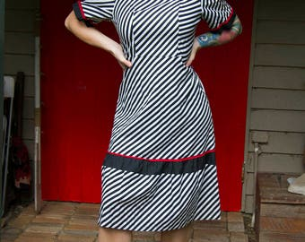 Striking vintage black and white wiggle dress with red trim