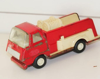 Vintage red Tonka firetruck toy, antique truck toy, collector's truck toy, red Tonka truck, vintage children's toys, red metal toy firetruck
