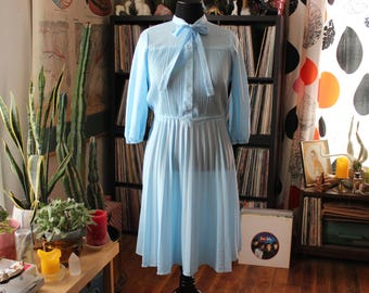 vintage powder blue dress . sheer secretary dress with pussybow & pleated skirt . womens size large