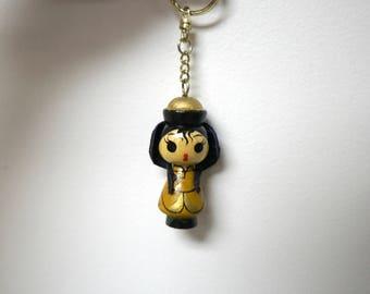 Asian doll . wooden key holder