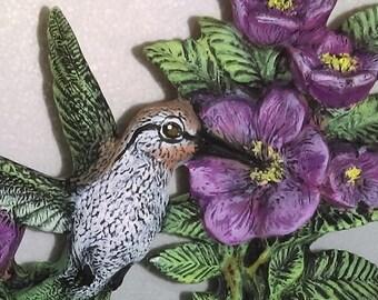 Humming bird in flight on flower ceramic figurine bird hand painted