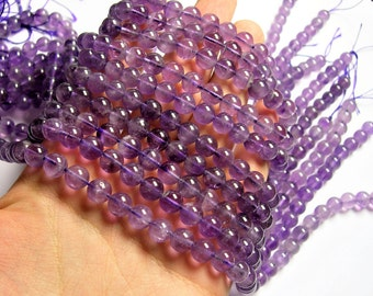 Amethyst - 8  round - 1 full strand - 47 beads - light amethyst - RFG560