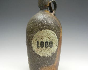 Salt/soda fired bottle with slip decoration