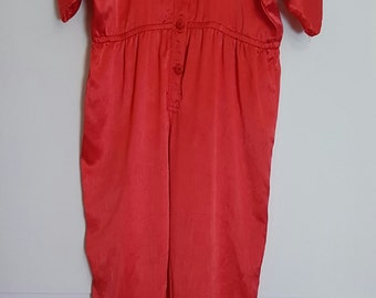 Vintage 1980s fire red bat-wing jumpsuit