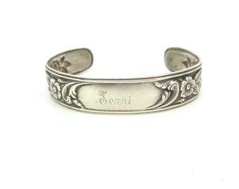 S. Kirk and Son Bracelet. Sterling Silver Floral Repoussé. Rose, Anemone. Narrow Cuff. Monogram 'Terri' Personalized Jewelry. Vintage 1950s
