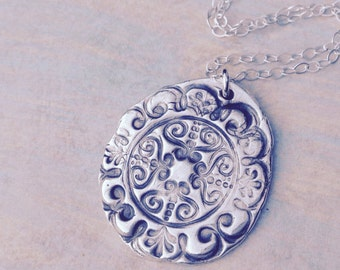 Boho tribal pattern silver pendant hand stamped from recycled silver