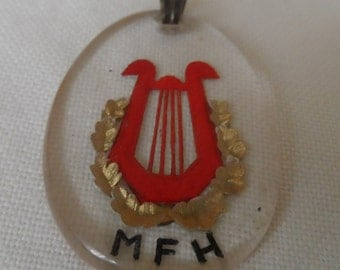 1940's reverse carved  lucite pendant MFH master of foxhounds?