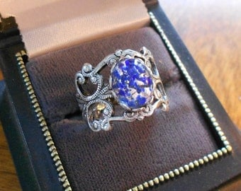 Vintage filigree silver ring with vintage stone.  Blue flecked.  Ladies jewelry.