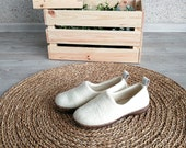 White felted shoes for women from natural wool with rubber soles