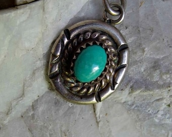 Native American Silver and Turquoise Pendant or Charm, Sky Blue Turquoise Cabochon, Sawtooth Bezel with Wire Twist and Tooled Border, Sweet