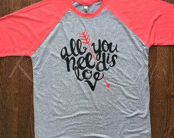 "Heart shaped ""all you need is love"" Raglan"