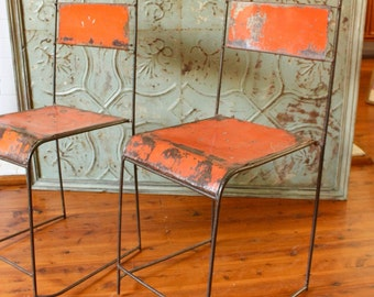 6 vintage Indonesian metal Hall Chairs stackable with rustic orange painted finish, stencilled detail to backs.