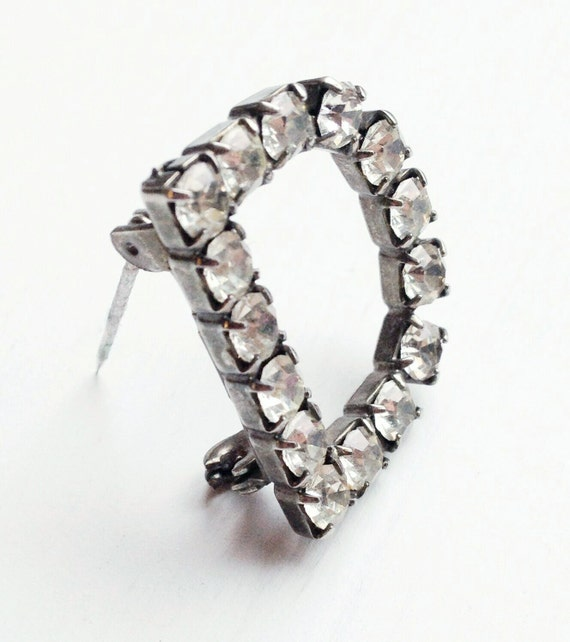 The D rhinestone minibrooch, because who couldn't use a little D?