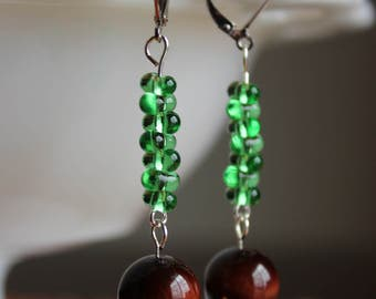 Green czech glass, red tiger eye, and Swarovski crystal pendant earrings