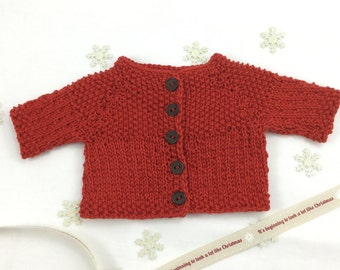 """Christmas Waldorf Doll cardigan in red (fits 14"""" doll)."""