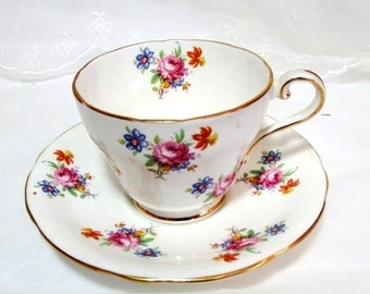 Vintage Aynsley Tea Cup and Saucer with Gilt trim Bone China Made in England , Pink Rose. Blue Daisy and Red Daffodil