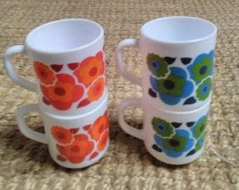 Four French white glass mugs lotus design