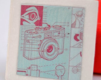 tile magnet with camera graphic blue green and pink