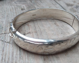 Vintage sterling silver hinged bangle with safety chain