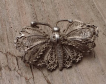 Small silver filigree butterfly brooch