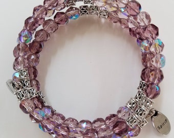 Beaded Czhecoslovakia crystal memory wire bracelet.  Faceted crystal beads in shades of lavender.  Silver plated spacers.  Free shipping.