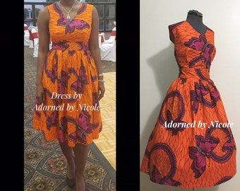 V-Neck African Print Dress: Yellow w Orange, and Black detail Cotton Dress