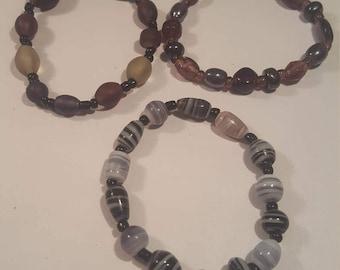 Set of 3 amethyst and black beaded bracelets