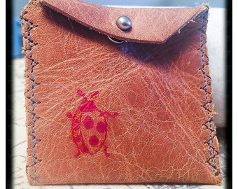 Leather pouch with ladybug print