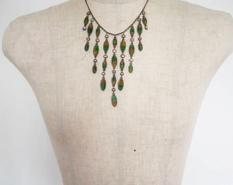 Tiered emerald coloured bead necklace