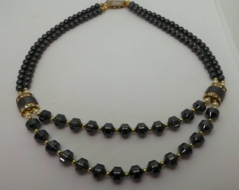 Vintage necklace - stunning hematite 2 strand necklace accented  with crystal and pearl.