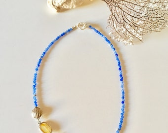 Beautiful blue necklace of semiprecious stones with side parts of chalcedony and silver.
