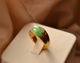 Sleek and luxurious solid 22K yellow gold ring set with cabochon-cut Jade stones