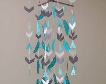 Feather and teepee baby mobile.
