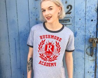 Rushmore Academy, Varsity Design | Grey Ringer Tee