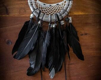 Handmade horseshoe dreamcatcher with black feathers