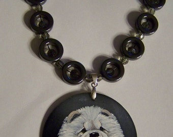Hand painted chow on shell with hematite  and  crystal necklace