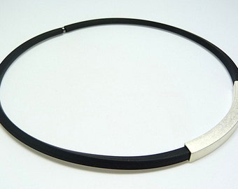 short black rubber necklace with silver-plated or gold-plated jewelry item