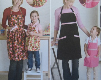 Simplicity 2555 -- Adjustable aprons for children and women. Make one match for you and your daughter. How fun would that be? Uncut and new.