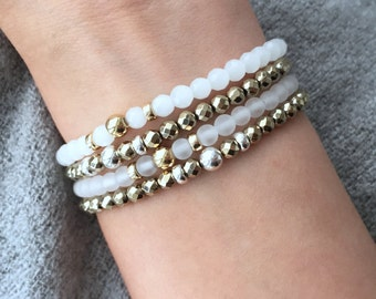 QUINSCO - Four Piece White and Gold/Silver Bracelet Stack