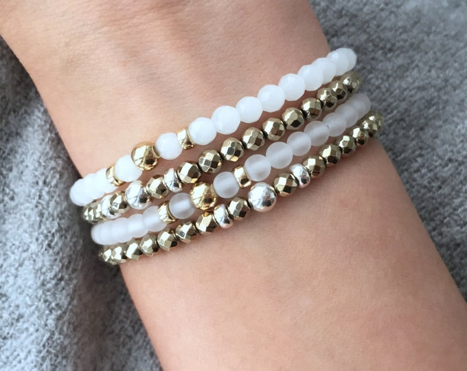 Featured listing image: QUINSCO - Four Piece White and Gold/Silver Bracelet Stack