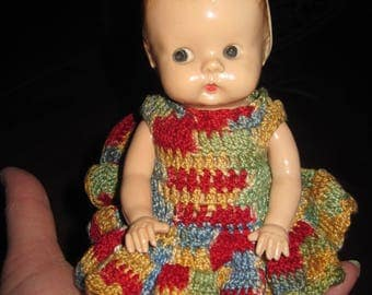 """Vintage 7"""" plastic doll with crocheted dress"""