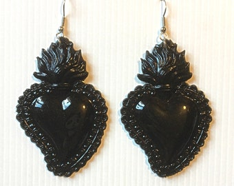 Dangling with sacred heart.